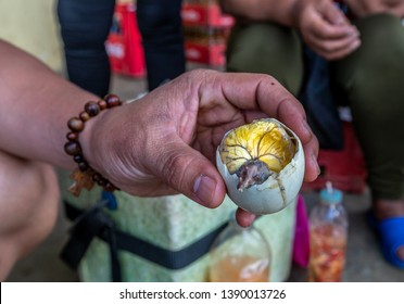 Balut egg - boiled egg with a little duckling or chicken.