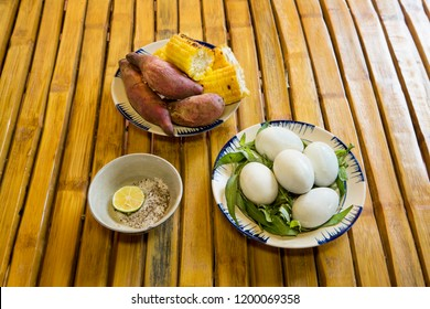 Baluts, baked sweet potatoes, grilled corn on a bamboo table. This is one of the special dishes and popular in Vietnam.