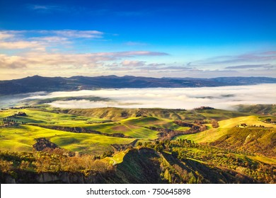 Balze of Volterra foggy morning panorama, farmlands and green fields, countryside landscape. Pisa, Tuscany, Italy. Europe.