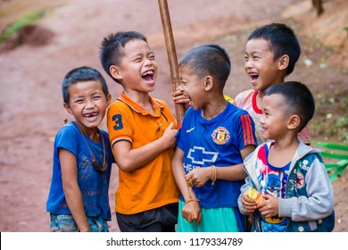 BAM PHOANSA AT , LAOS - AUG 14 : Laotian children from the village Bam Phoansa At , Laos on August 14 2018. nearly 70 percent of the population in Laos lives in villages