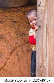 BAM PHOANSA AT , LAOS - AUG 14 : Laotian child from the village Bam Phoansa At , Laos on August 14 2018. nearly 70 percent of the population in Laos lives in villages