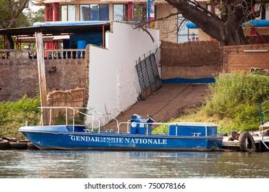 BAMAKO, MALI - CIRCA FEBRUARY 2012: Gendarmerie Nationale boat on the river Niger in Bamako