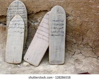 BAMAKO, MALI, DECEMBER 16 2009: Koran verses written on wood panels are used for teaching in a madrassa on December 16 2009 in Bamako