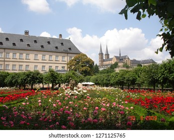 Bamberg, Bavaria, Germany - July 2009: Rose Garden at the New Palace with the Bamberg Cathedral in the background in Bamberg