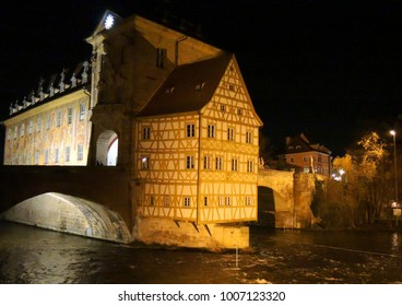 Bamberg. Germany. An artificial island across the river Regnitz. City Hall Bamberg at night. Both bridges connect it to both banks.