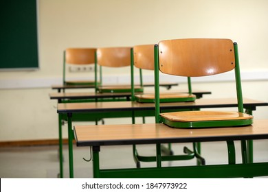 Bamberg, Germany. August 31, 2020. Chairs stacked on desks in a deserted classroom in a German school as schools get ready for the end of the summer vaction and a return to teaching in Corona times.