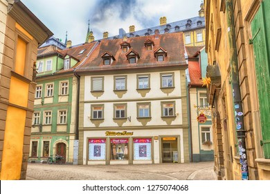Bamberg, Germany - February 19, 2017: Bamberg city center street view with colorful german traditional houses