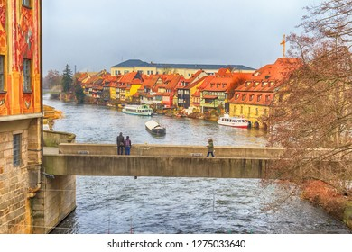 Bamberg, Germany - Ferbuary 19, 2017: Bamberg city center street view with houses and bridge over the river