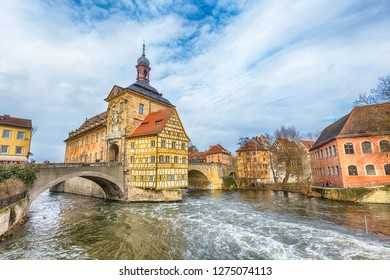 Bamberg, Germany - Ferbuary 19, 2017: Icon of Bamberg Obere bridge or brucke and Altes Rathaus town hall, Germany