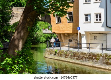 Bamberg, Germany - June 15, 2019: arm of the river Regnitz in the old town of Bamberg, Bavaria, with unidentified people. Bamberg is a city in Bavaria and well known for its medieval old town