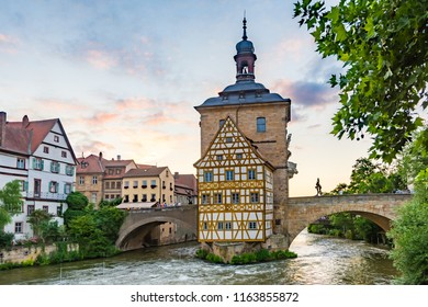 BAMBERG, GERMANY - JUNE 19: Tourists at the historic town hall in Bamberg, Germany on June 19, 2018. The famous town hall was built in the 14th century.