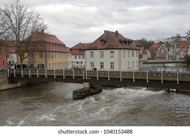 Bamberg, Germany - March 28, 2009 : buildings and bridge over River Regnitz in a cloudy day