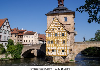 Bamberg. Panoramic view of Old Town Hall of Bamberg (Altes Rathaus) with two bridges over the Regnitz river, Bavaria, Germany