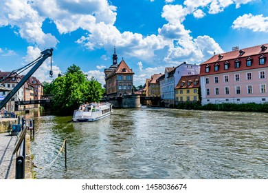 Bamberg,Germany-Juni 19,2019:Tourists on the cruise ship in the background the old town hall, a main attraction for tourists in the Bavarian city of Bamberg