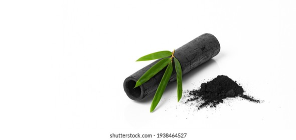 Bamboo activated charcoal stick, green leaf and coal powder isolated on white background