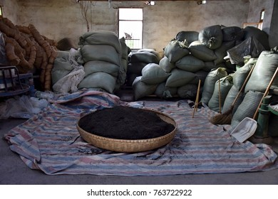 The bamboo basket brimfull of the black Chinese tea. Inside the tea factory.