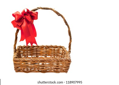 Bamboo basket isolated on white background Decorated with red ribbons on top