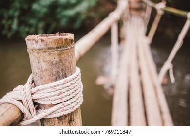 Bamboo bridge across the stream