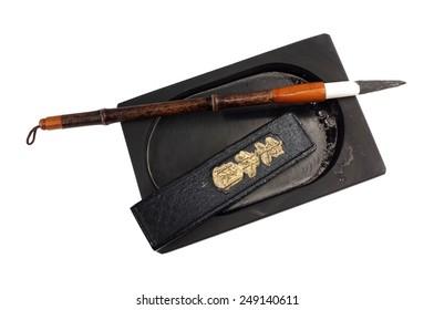 bamboo calligraphy brush inkstone and inkstick isolated on white