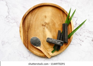 Bamboo charcoal and powder on marble table. copy space