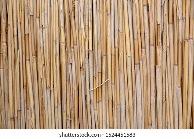 bamboo covered roof top close-up background texture.