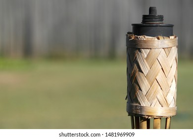 Bamboo Fire stick on grass and fence background