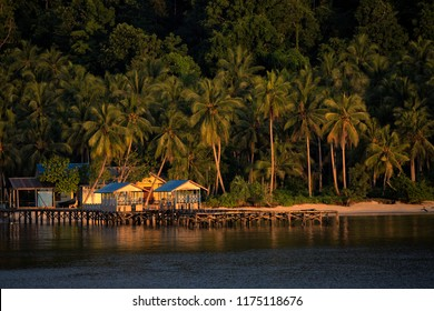 Bamboo Hut and cottage around the pier on Arborek Island with the morning light in Raja Ampat, West Papua, Indonesia,