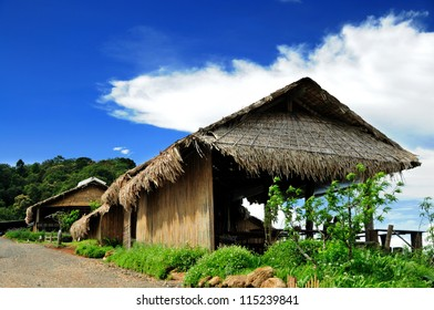 Bamboo hut in hill tribe village with cloud and blue sky  , Chiang mai ,Thailand