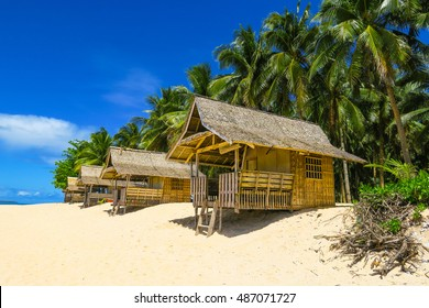 Bamboo Huts & Palm Trees on Paradise Island Beach - Siargao, Philippines