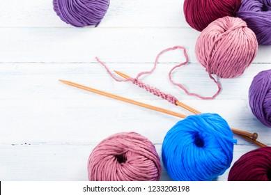 bamboo knitting pins and balls of wools