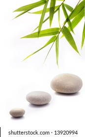 bamboo leafs and three stones isolated on white
