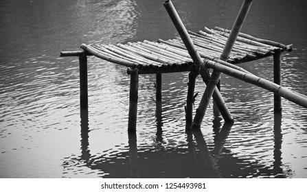 Bamboo made structure on top of a lake unique photo