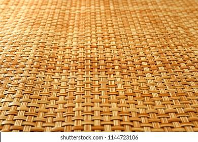 Bamboo mat Light brown background.focus center matt