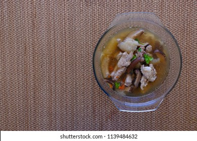 Bamboo Mushroom soup broth in the Glass bowl, the soup have the pork rip, Shiitake mushroom, Goji berry are ingredient, the Bamboo Mushroom have are more name is Dictyophora indusiata Bamboo fungus