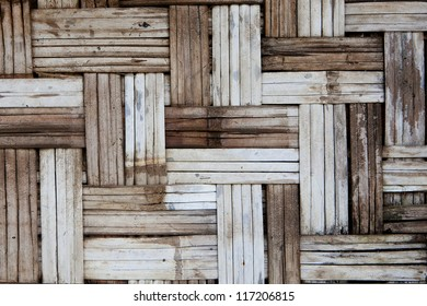 The bamboo panel made from pieces of bamboo wood and arranged in asian traditional pattern.