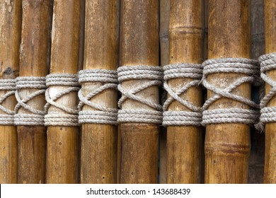 Bamboo panel with a rope tied.Rope style.Lasso pattern.