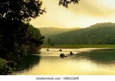 Bamboo raft floating in clear water in the morning at Pang Oung Lake (Pang Tong reservoir), Mae hong son, Thailand.
