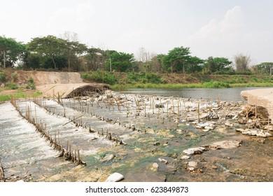 Bamboo reinforced concrete dams break down