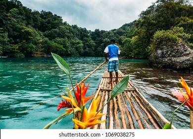 Bamboo ride in blue lagoon on Jamaica