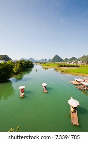 bamboo river boats drifting on the river in yangshuo guillin , china.
