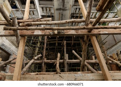 Bamboo scaffolding for builder at construction site.