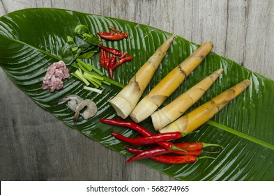 Bamboo shoot and ingredients on banana leaf.