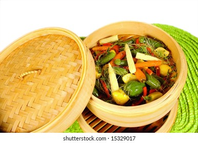 Bamboo steam cooker with vegetables