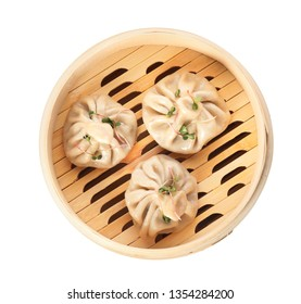 Bamboo steamer with tasty baozi dumplings on white background, top view