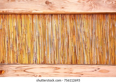 Bamboo sticks panel between two wooden planks