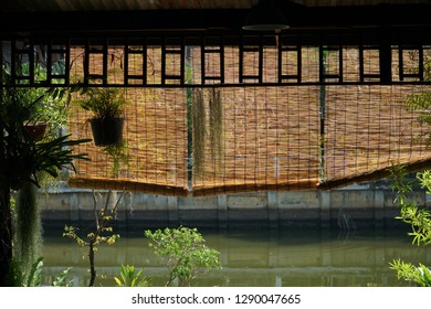 Bamboo sunshade awning hanging in house near canal, vintage sunshade made form bamboo, it's creative for decoration vintage style.