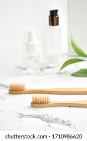 Bamboo toothbrush made.  light gray marble surface, white background. Biodegradable personal care products. No plastic concept. Zero waste.