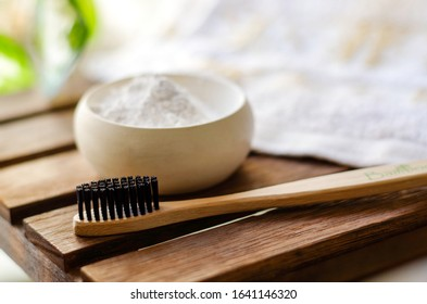 Bamboo toothbrush with tooth powder. Copy space