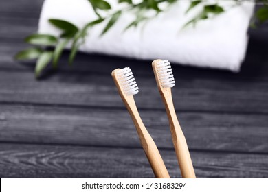 Bamboo toothbrushes on black background