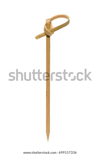 Bamboo toothpick closeup isolated on white background.